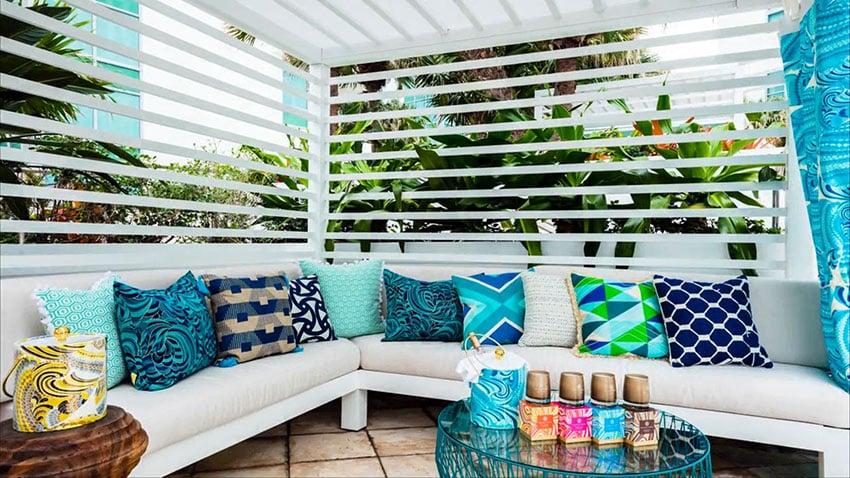 White slatted cabana with blue decor