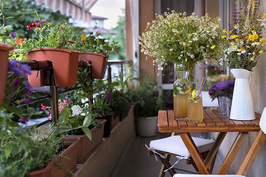 Balcony flower planters on fence rail