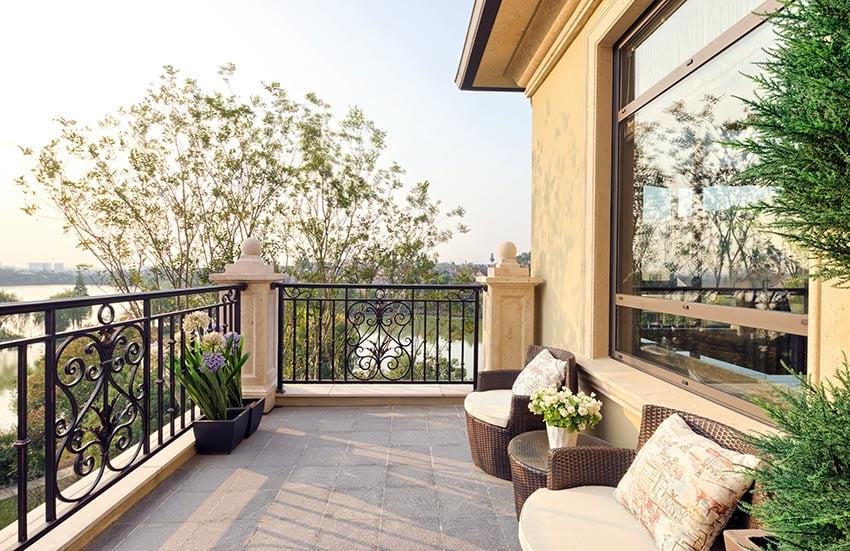 Balcony with wrought iron fence and flower planters