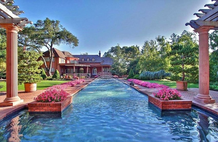 Beautiful backyard with custom swimming pool with brick flower boxes