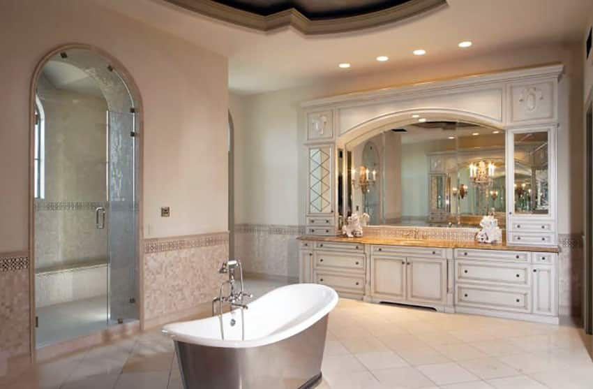 Beautiful bathroom with curved shower steam door and freestanding bathtub