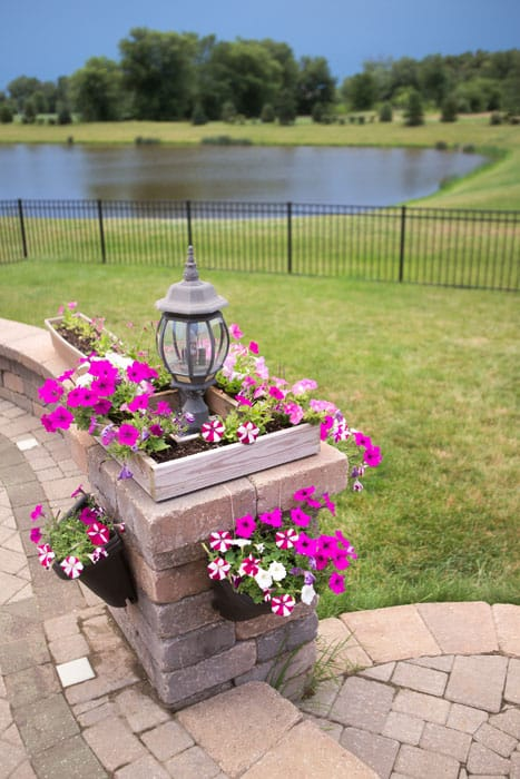 Brick pillar with lamp and flower box