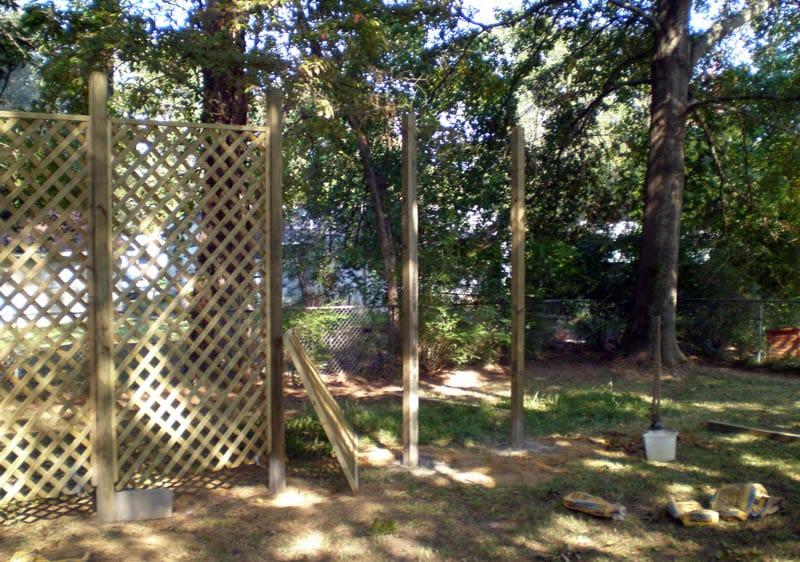 Building lattice fence in backyard