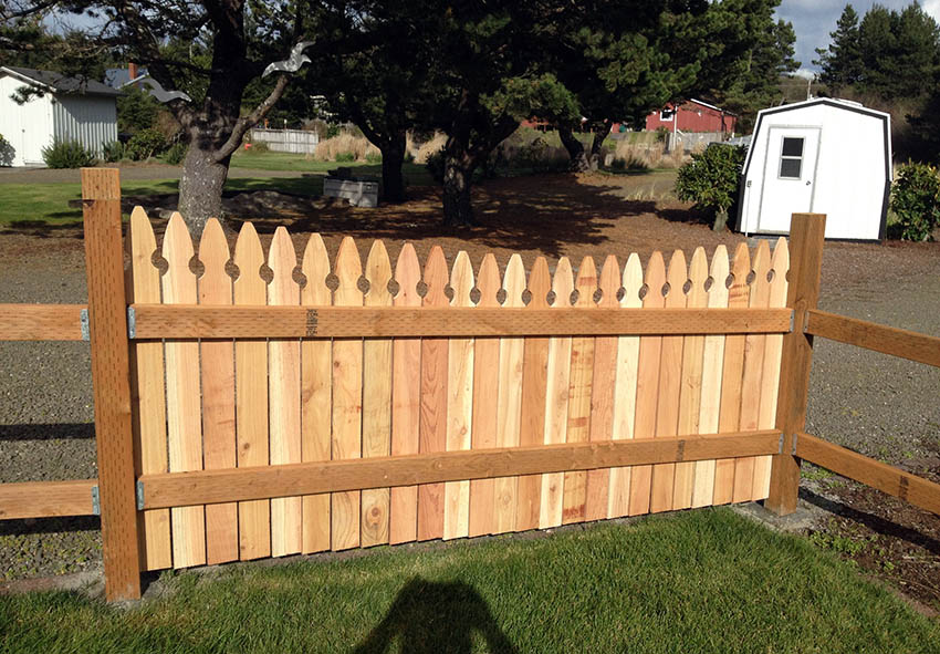 Cedar picket fence with pressure treated posts