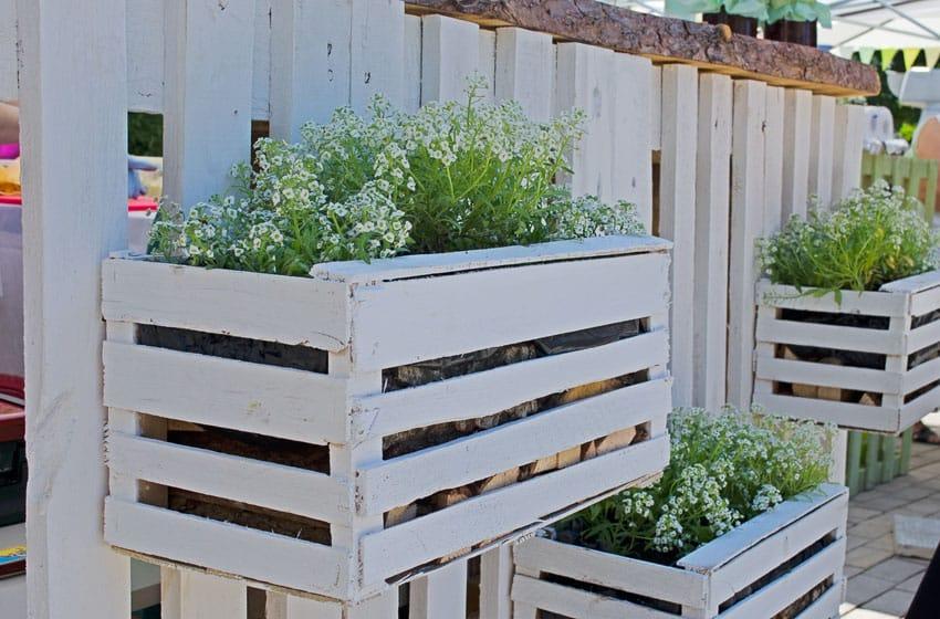 DIY white wooden flower box on fence