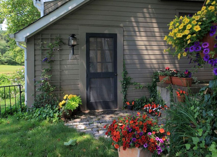 Front door to cottage with portable flower box
