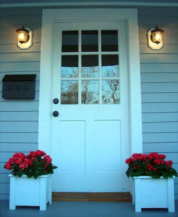 Front entrance to cottage with flower boxes