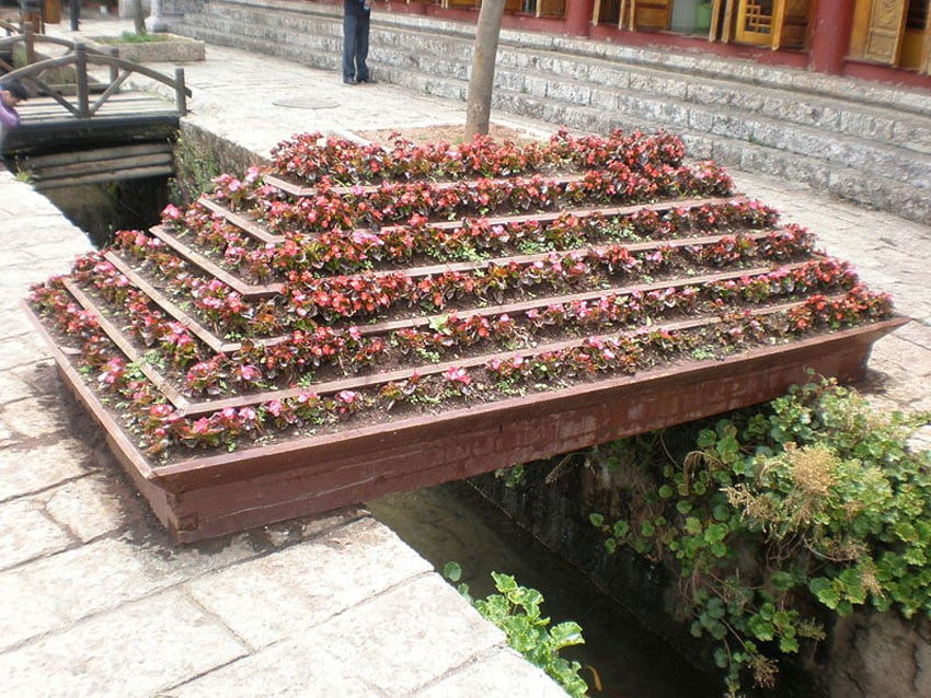 Large multi level flower box above water feature