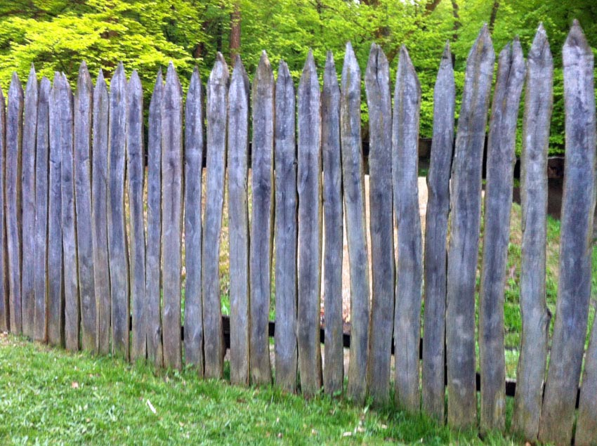 Rough wood picket stockade fence