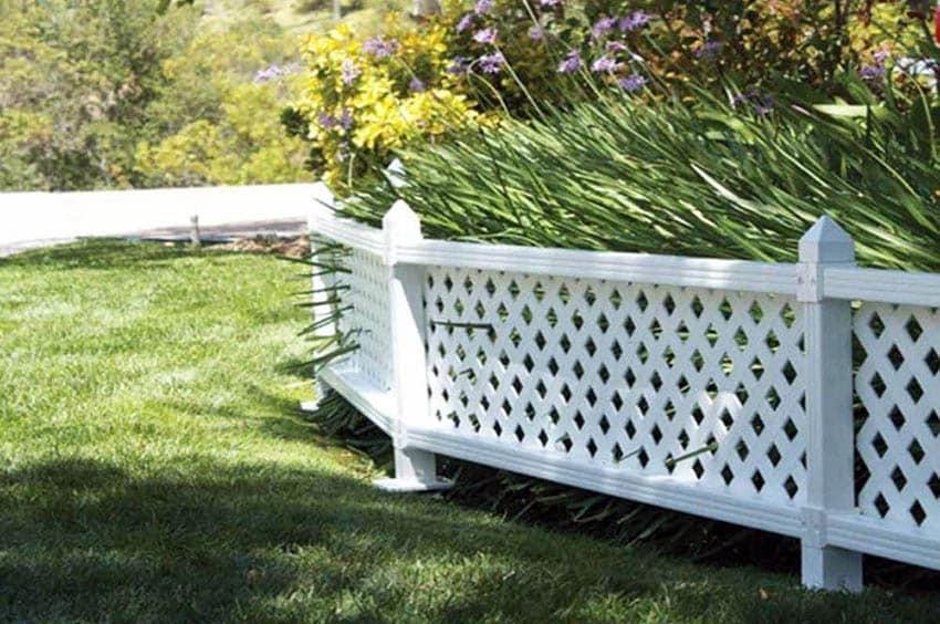 Short white vinyl fence panel in garden