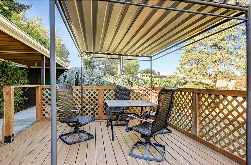 wood-deck-with-lattice-fence-and-aluminum-canopy-shutterstock_502193659