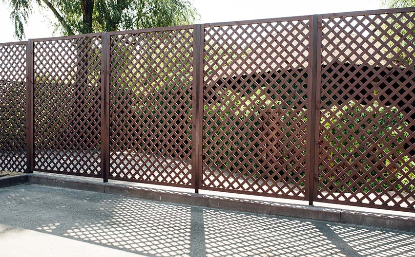 Wood lattice fence with grid design