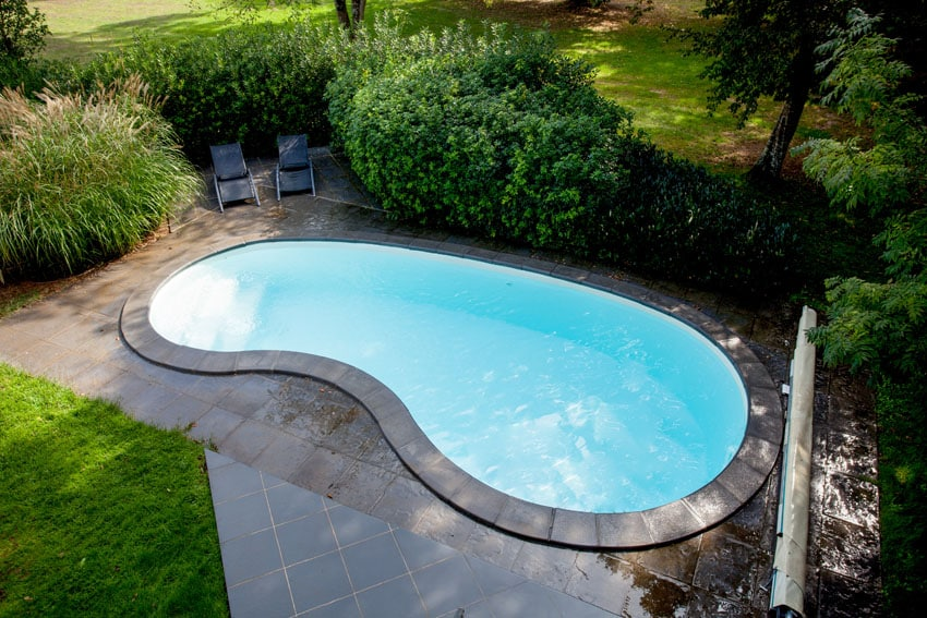 Beautiful kidney shaped pool with sitting patio