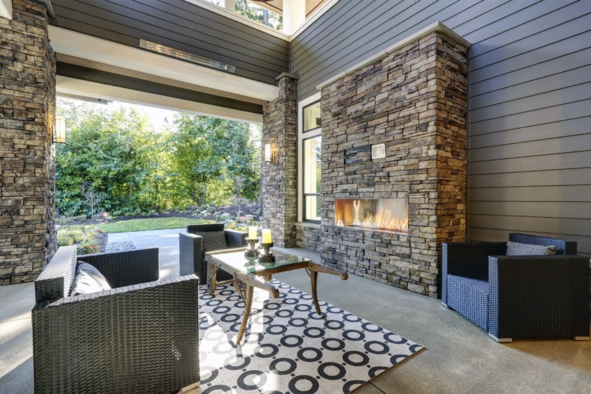 Beautiful patio with contemporary fireplace with stacked stone facade