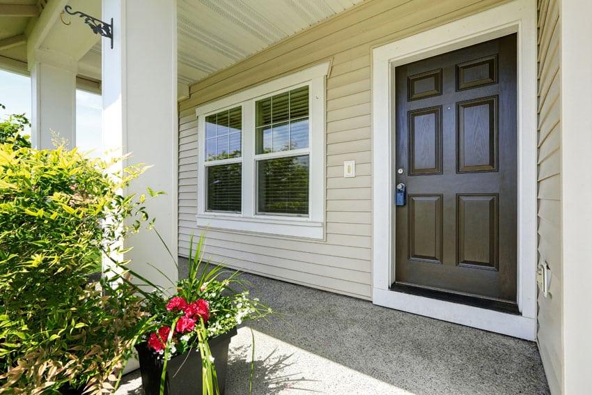 Beige house with brown door