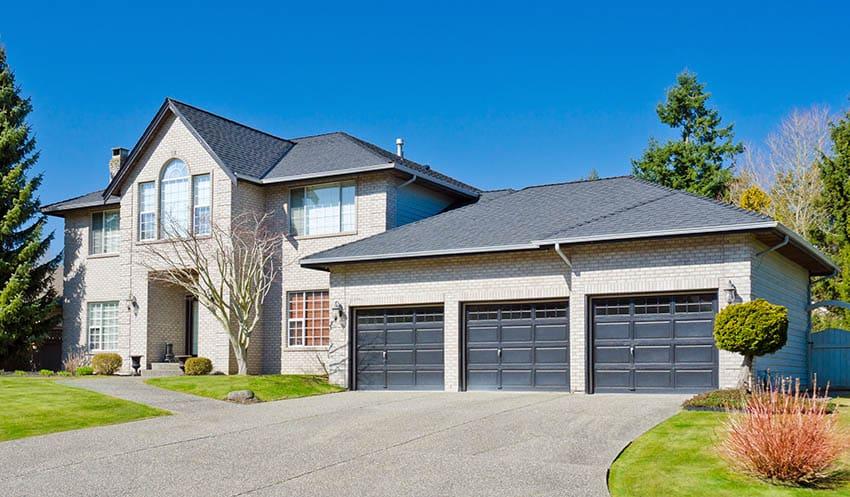 Black garage with triple doors house