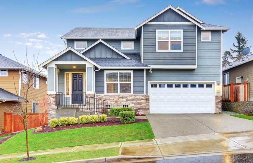 Blue house white garage door