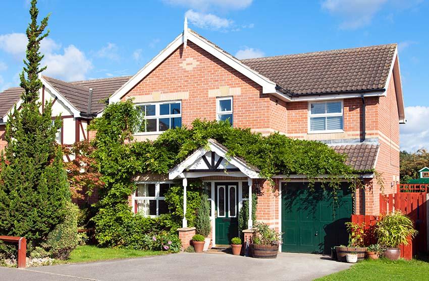 Brick house with green garage door and front door