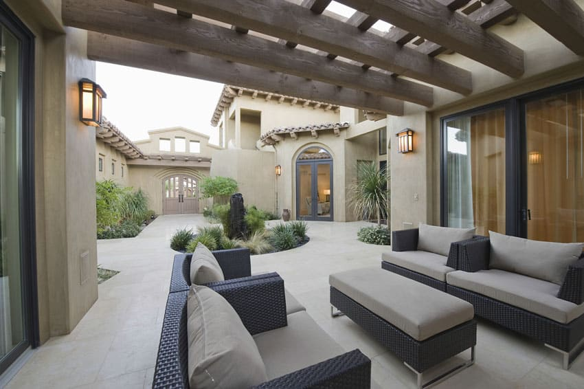 Concrete patio with wood pergola and outdoor furniture
