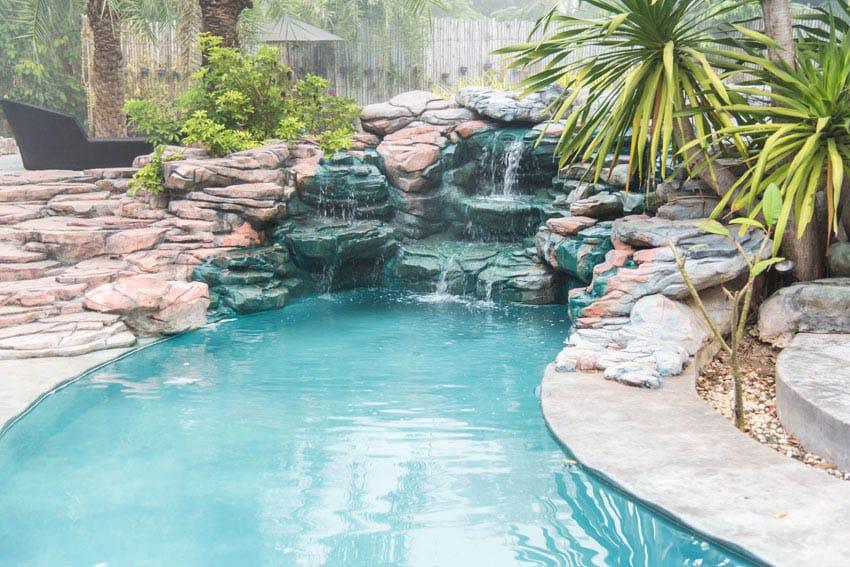 Custom rock swimming pool with waterfalls