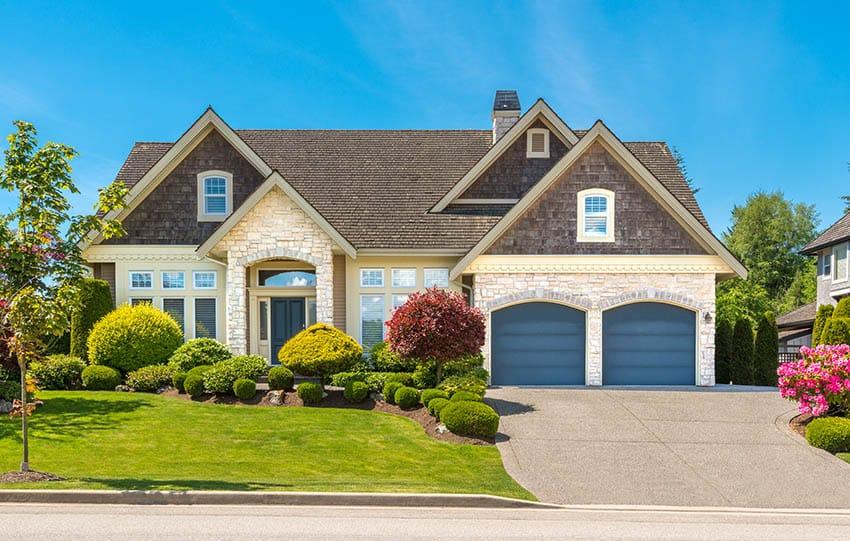 Dark blue garage doors house