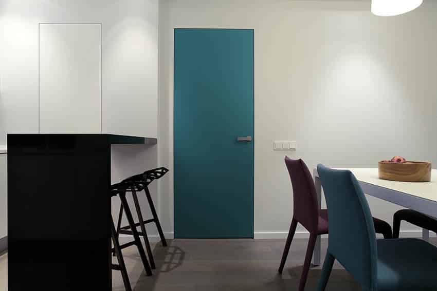 Green metal interior door in apartment