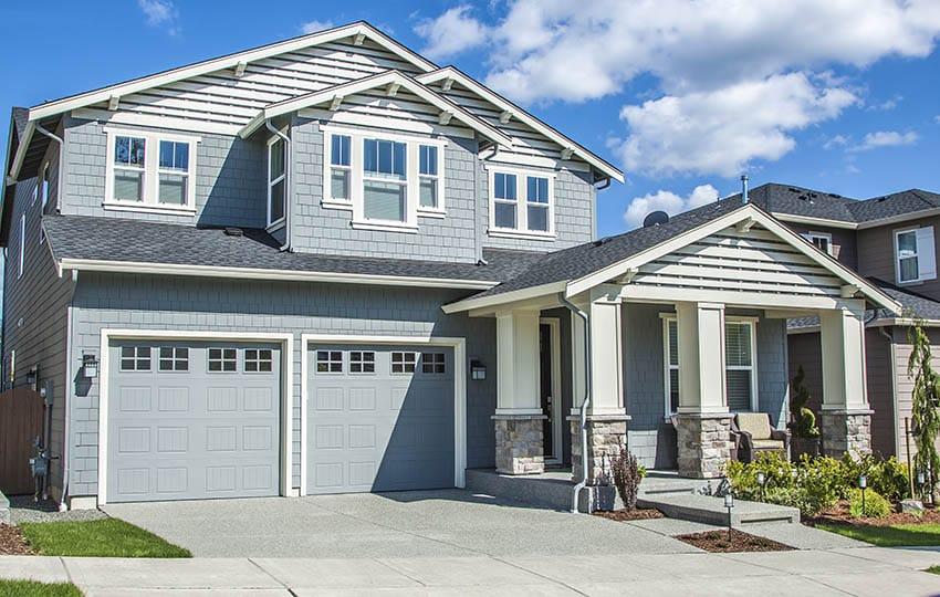 Light blue garage door house