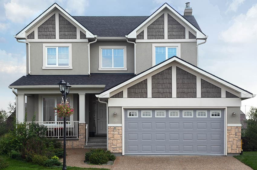 Light gray garage door house
