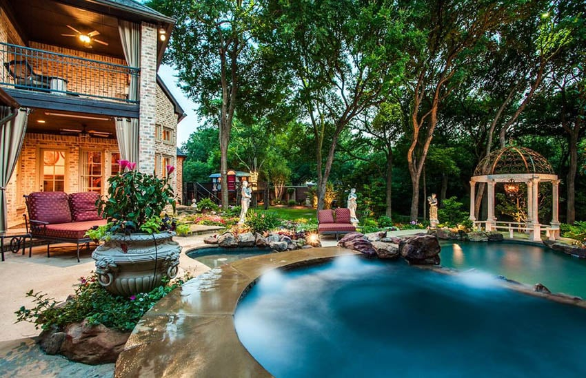 Luxury backyard with dark blue swimming pool and garden gazebo