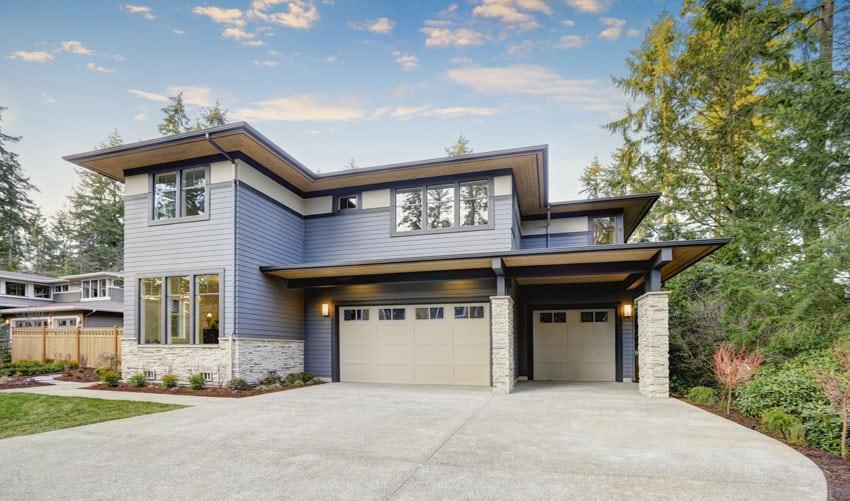 Luxury house with beige garage door