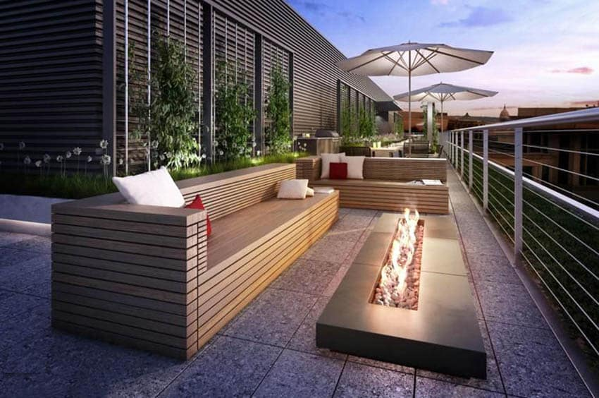 Modern patio with rectangular gas fire pit and stainless steel railings