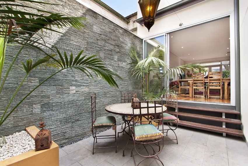 Modern patio with textured accent wall