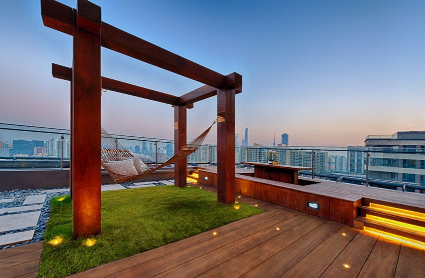 Modern rooftop patio with wood structure with hammock and wood deck