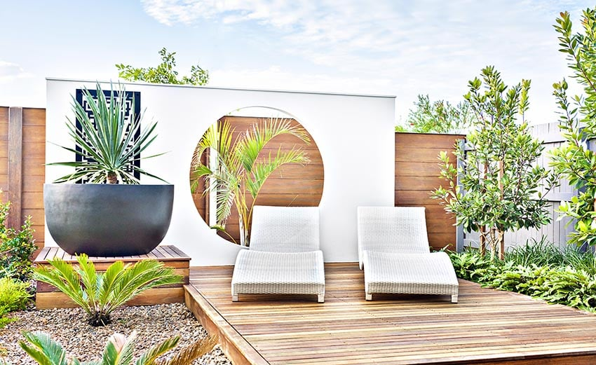 Modern wood deck with art wall and landscaping