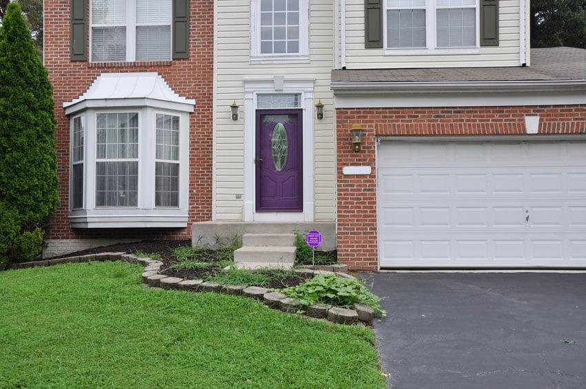 Purple front door on home