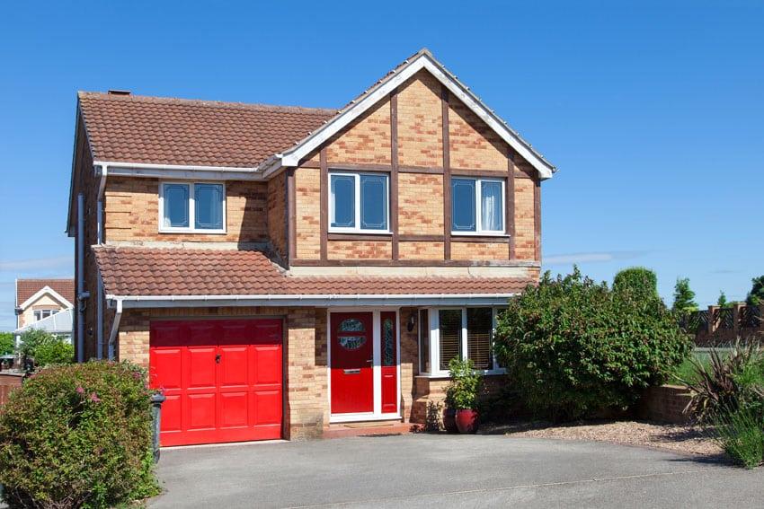 Red garage door color on brick house