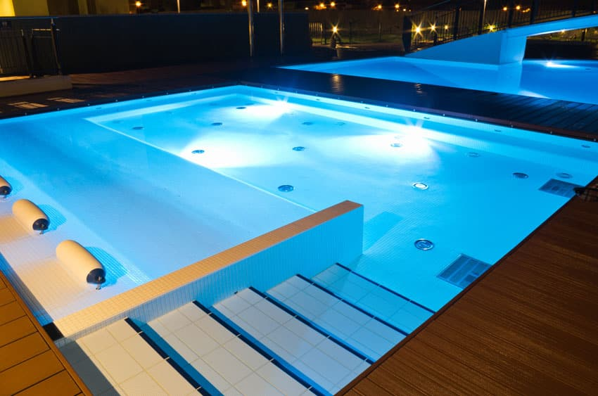Modern swimming pool with built in underwater lounge seating