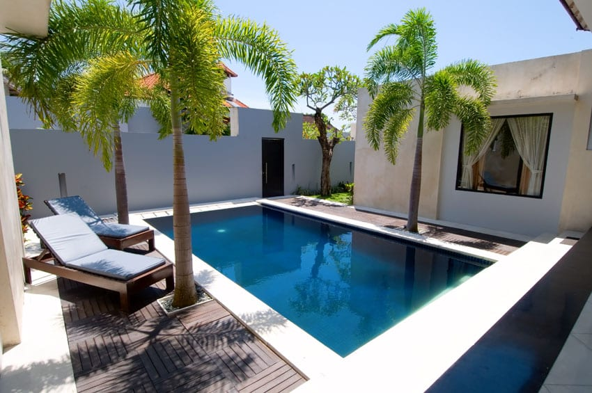 Small backyard swimming pool with deck