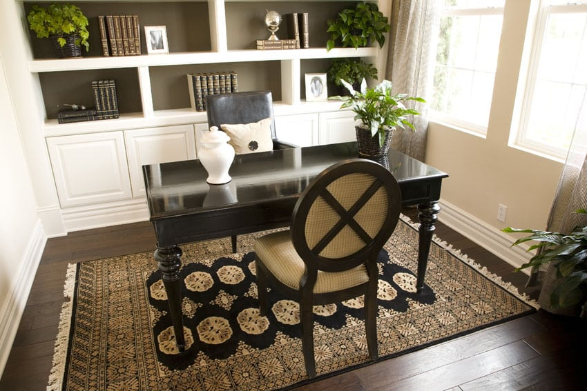 Small home office with built in bookshelves