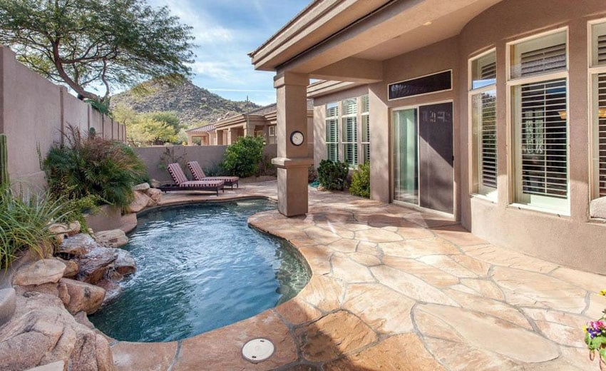 Small kidney swimming pool with flagstone patio