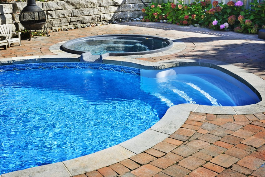 Small pool with hot tub and round entry