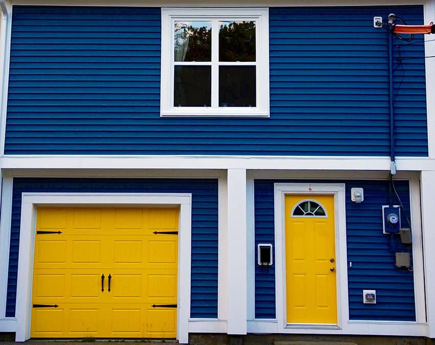 Yellow garage door house