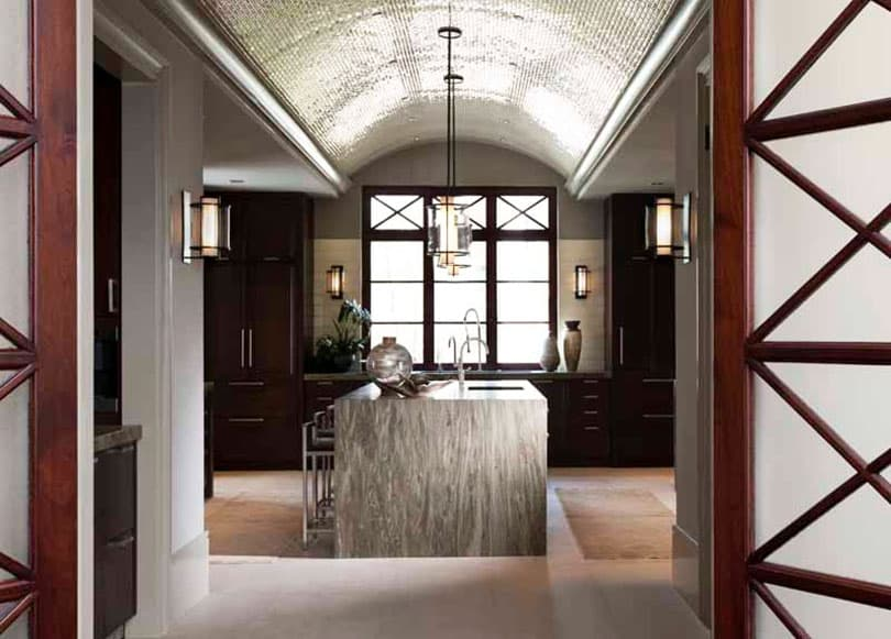 Contemporary kitchen with waterfall island dark cabinets and domed ceiling