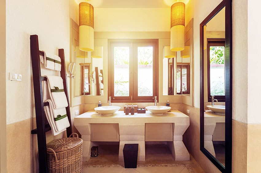 Japanese style bathroom with dual sinks and drum basket pendant lights
