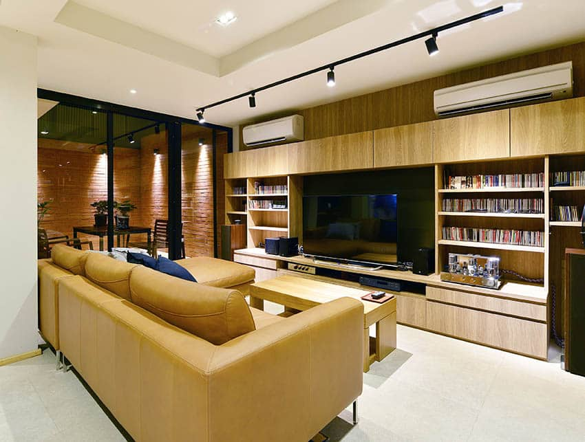 Living room with leather couch and large entertainment center
