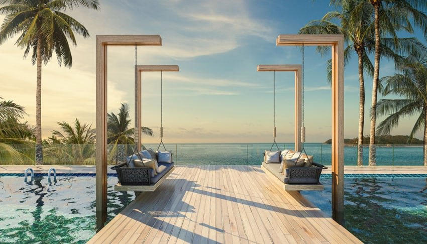Luxury swimming pool with wood deck bridge and hanging benches