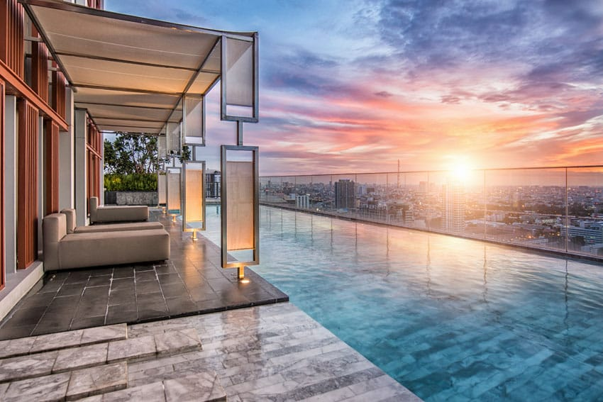 Modern penthouse swimming pool with cabana and city views