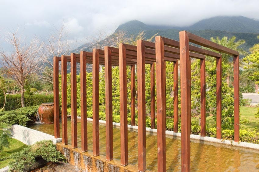 Modern pergola above water feature pond with mountain views