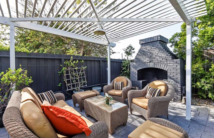 Modern pergola with patio outdoor fireplace and furniture