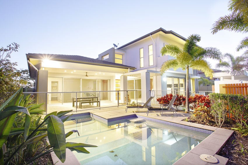 Modern pool with tropical landscaping